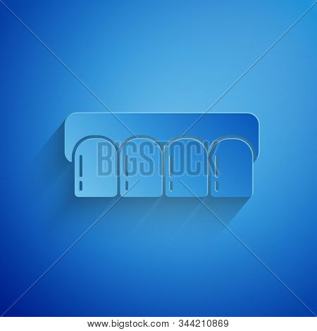 Paper cut Dentures model icon isolated on blue background. Teeth of the upper jaw. Dental concept. Paper art style. Vector Illustration stock photo