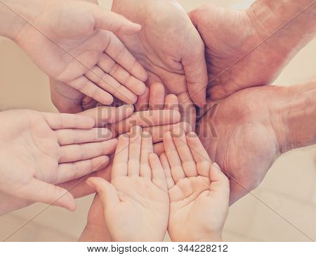 Many hands together: group of people joining hands stock photo