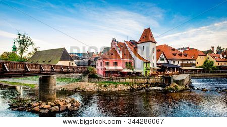 Beautiful view of bridge and architecture on the river bank of the Cesky Krumlov stock photo