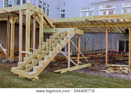 Installing deck patio construction. boards with above ground deck stock photo