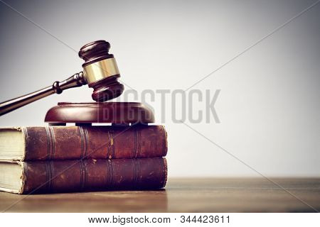 Judge gavel and law books in court, law and justice background concept with copy space stock photo