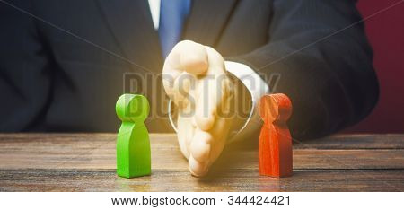 Man divides warring parties conflict with a hand. Mediator services. Stop fight, ceasefire clashes. Finding a compromise. De-escalation of conflict. Avoid the war, start the negotiation process stock photo
