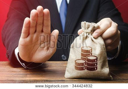 Businessman refuses to give money bag. Refusal to grant loan mortgage, bad credit history. Financial difficulties. Refuses cooperate. Economic sanctions, confiscation funds. Asset freeze seizure stock photo