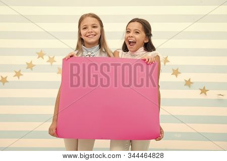 Congratulations concept. Amazing news. Girls hold congratulations banner. Kids holding banner for announcement. Children happy blank paper greetings copy space. Happy holidays. Congratulations to you. stock photo