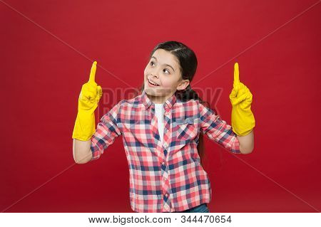 Lets do some work. Happy girl got idea. Little child wear rubber gloves. Small helper ready for cleaning work. Housekeeping routine. Household activity. Doing house work. Cleaning that works. stock photo