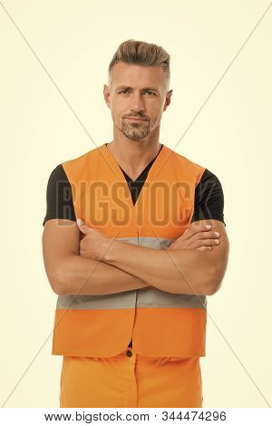 High visibility reflective safety vest. Safety is main point. Man worker protective uniform white background. Protective and safety equipment concept. Safety apparel for construction industry. stock photo