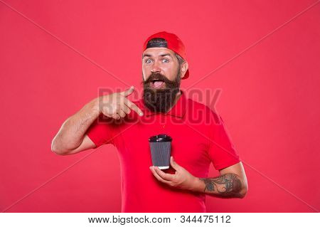 Morning tradition. good morning coffee to go. Barista recommend caffeine beverage. bearded man drink from paper cup. brutal hipster red uniform. Coffee shop staff wanted. perfect morning with coffee. stock photo