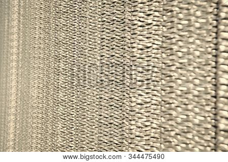 Sharp metallic texture. Silver foil background. Metal surface lathing. Metallic netting. Protective material. Metal recycling. Metallic screen. Industrial concept. Iron producing. stock photo