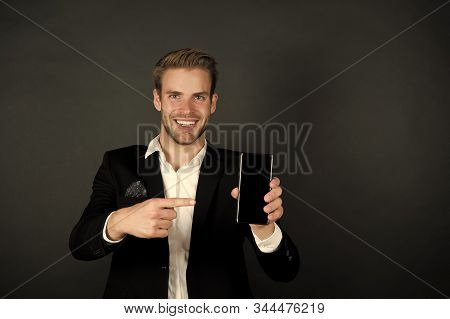 Solution for business. Download new version. Software update. Guy bearded smartphone user. Guy shows smartphone screen copy space. Man satisfied try application for smartphone. Useful application. stock photo