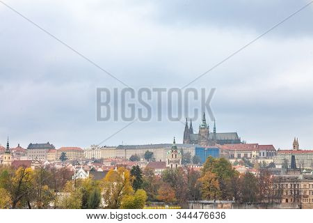 Panorama of the Old Town of Prague, Czech Republic, in autumn, at fall, with Hradcany hill and the Prague Castle with the St Vitus Cathedral (Prazsky hill) seen from Vltava river. It is the main landmark of the city. stock photo