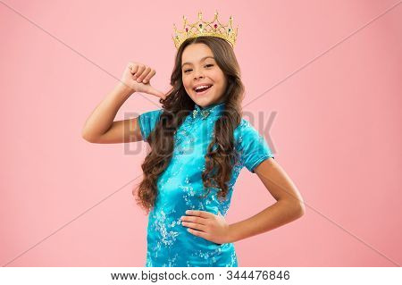 Beauty pageant. Focus on beauty. Little princess. Girl wear crown. Princess manners. Award concept. Winner of beauty competition. International beauty contest. Kid wear golden crown symbol of glory. stock photo