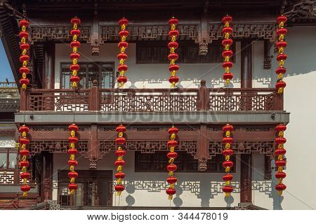Ancient city landscape,Chinese traditional architectural structure with strings of red lanterns in Yu Garden of Shanghai stock photo