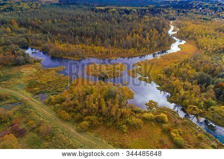 Panorama of the Izvarka river in golden autumn (aerial photography). Leningrad region, Russia stock photo