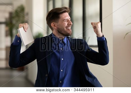 Applicant celebrating successful job interview ending got position feels happy stock photo