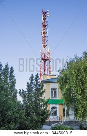 Telecommunications tower against a blue sky .  Radio and satellite pole. Communication technology. Telecommunication industry. Mobile or telecom 4g network. Antenna on blue sky. stock photo