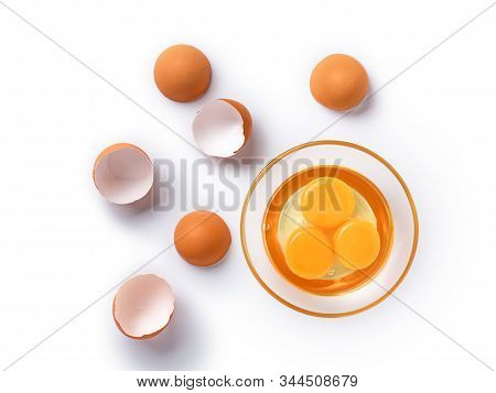 Top view and close up image of organic chicken eggs are one of the food ingredients on white background. Organic chicken eggs food ingredients concept. stock photo