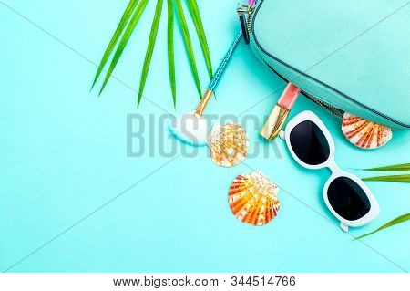 Travel feminine accessories and cosmetics  on blue background. Copy space. Color 2020 stock photo