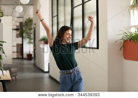 Emotional student girl celebrating successful exam pass stock photo