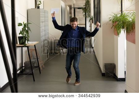 Male applicant after job interview feels happy got new work stock photo