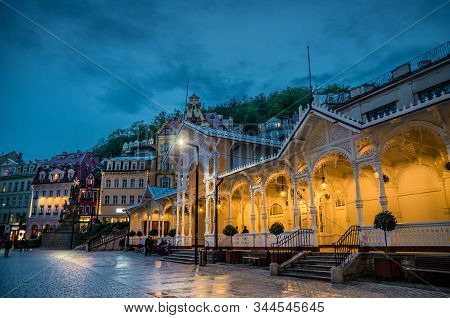 The Market Colonnade Trzni kolonada wooden colonnade with lights and hot springs in town Karlovy Vary Carlsbad historical city centre, night evening view, West Bohemia, Czech Republic stock photo