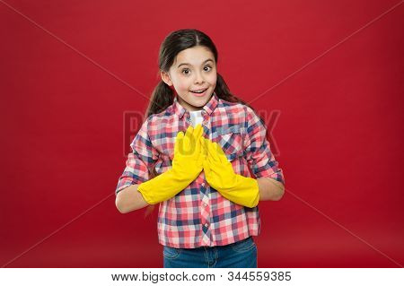 Cleaning service. Little cleaning lady red background. Small child wear rubber gloves. Domestic cleaning. Housekeeping routine. Household work. Do housework. All for cleaning. No more dust. stock photo