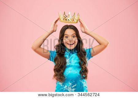 International beauty contest. Kid wear golden crown symbol of princess. Become princess. Lady little princess. Girl wear crown. Princess manners. Award concept. Winner of beauty competition. stock photo