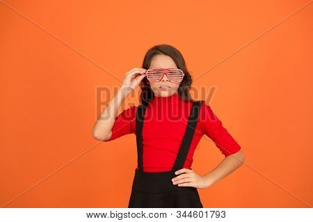 Strict look. Serious girl wear party glasses. Little child with funny glasses. Holiday celebration. Pair of glasses. Fashion accessory. My glasses as unique as me. stock photo