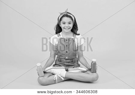 Yoga training. KId girl sit meditate. Meditating practice. Good vibes. Peaceful meditating. Vegetarian smoothie drink. Learn meditating techniques. Stay positive and optimistic. Healthy way of life. stock photo