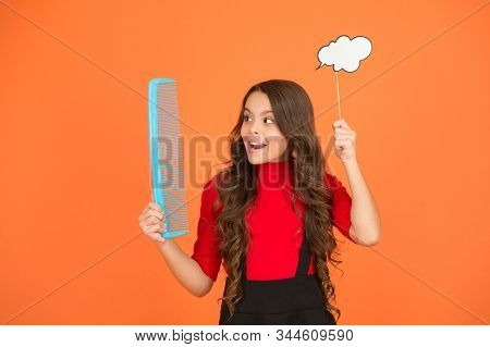 Communication. Inspiration creating hairstyle. Idea for hair. Get rid of annoying tangles. Girl long hair hold comb and speech bubble. Hairdresser salon. Combing hair. Styling tips. Tangled hair. stock photo