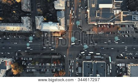 Aerial view of city intersection with many cars and GPS navigation system symbols. Autonomous driverless vehicles in city traffic. Future transportation concept. stock photo