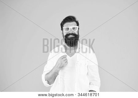 join the party. Good mood. ready for holiday celebration. Smart nerd eyeglasses. Last minute costume party ideas. how nerds have fun. barbershop concept. bearded man party glasses. Party accessory. stock photo