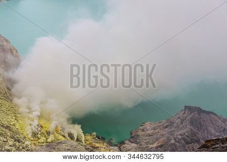 Lake in a Crater of Volcano Ijen, Java, Indonesia stock photo