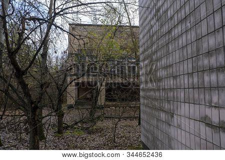Chernobyl pripyat abandoned exterior abandoned buildings with wild vegetation stock photo