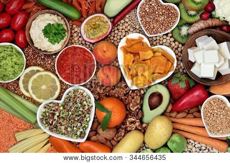 Healthy diet vegan food with grains, nuts, dips, bean curd, fruit, vegetables, legumes & spice. Food high in antioxidants, vitamins, dietary fibre, smart carbs & protein. Plant based diet concept.  stock photo