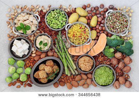 Healthy vegan food for fitness concept with foods high in protein, anthocyanins, vitamins, minerals, antioxidants, smart carbs, omega 3 and fibre. Ethical eating concept. Flat lay, top view. stock photo