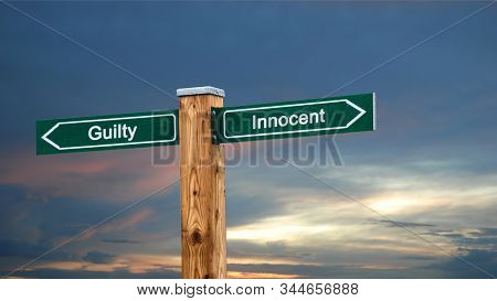 Street Sign the Direction Way to Innocent versus Guilty stock photo