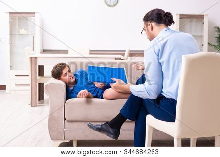 Internet addicted boy visiting male doctor stock photo