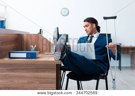 Young leg injured employee in the office stock photo