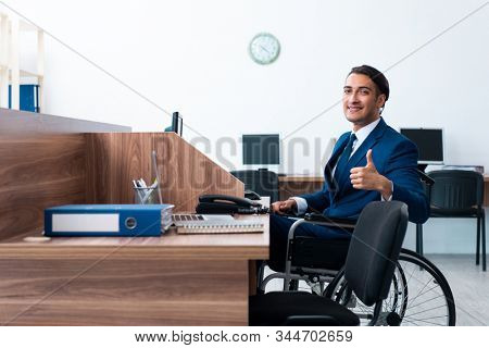 Young male employee in wheel-chair stock photo