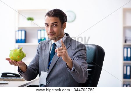 Young male accountant working in the office stock photo