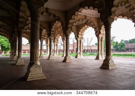 Diwan-I-Am (Hall of Audience) in Agra Red Fort from inside with ambient light creating soft shadows and overexposed bright sky as a contrast between luminance levels stock photo