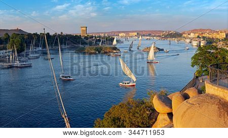 Beautiful panorama landscape with felucca boats on Nile river in Aswan at sunset, Egypt stock photo