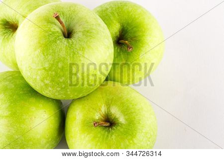 close up ripe green apple on white background fruit agriculture food isolated stock photo