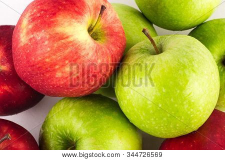 green apple and red apple close up on white background fruit agriculture food isolated stock photo