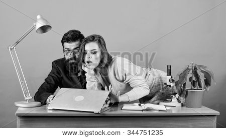 woman and man work in office at laptop. secretary with boss at workplace. business couple at computer. businessman and assistant solve problem. love affair at work. . Everyday winners stock photo