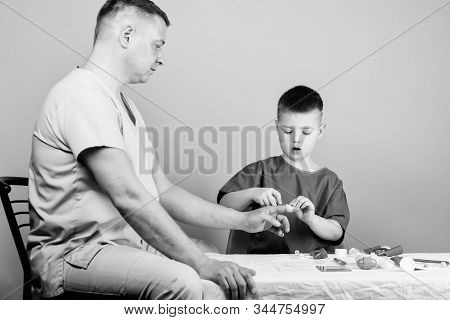 medicine and health. childhood. parenting. family doctor. father and son in medical uniform. happy kid with dad with stethoscope. small boy with dad in hospital. happy parenting. parenting happiness stock photo