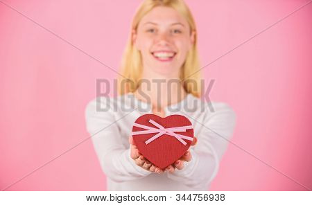 She romantic person. Valentines gift for boyfriend. Find special gift for boyfriend fiance or husband. Romantic surprise gift for him. Female hands hold gift box. Prepared something special for him stock photo
