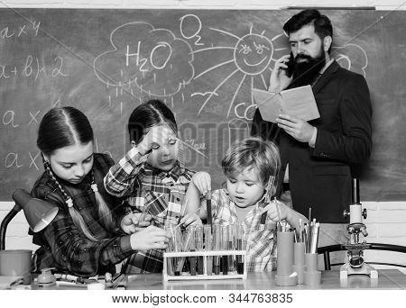 With experience comes knowledge. Formal education. Chemistry classes. Group interaction and communication. Promote scientific interests. Practical knowledge. Teaching kids sharing important knowledge stock photo