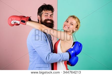 Difficult relationships. Couple in love competing boxing. Conflict concept. Family life. Boxers fighting gloves. Man and woman boxing fight. Complicated relationships. Couple romantic relationships stock photo