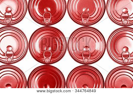 Close up photo of red aluminium cans in a raw isolated on white background. Aluminium can background. Can Pattern. Aluminium beverage cans. Drink can. Metal containers for packaging drinks. stock photo
